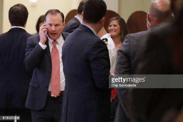 Sen Mike Lee takes a break from the weekly Senate Republican policy luncheon to talk on the phone outside the Mansfield Room at the US Capitol July...