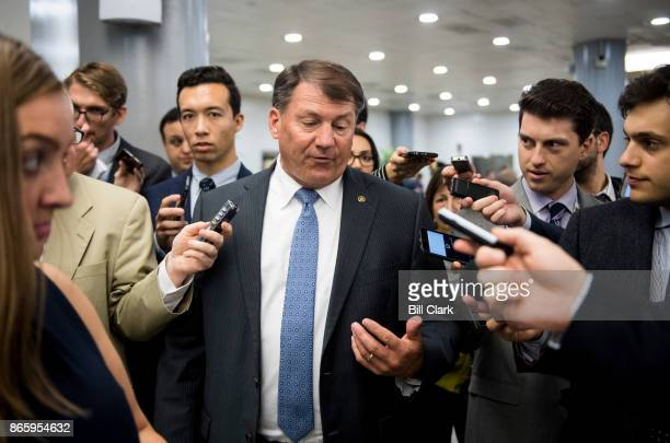 Sen Mike Rounds RS Dak speaks to reporters as he leaves the Senate Republicans' policy lunch with President Donald Trump in the Capitol on Tuesday...