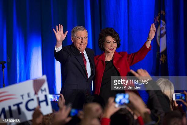 S Sen Mitch McConnell celebrates with his wife Elaine Chao at his election night event November 4 2014 in Louisville Kentucky McConnell defeated...