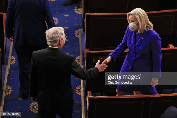 Sen. Mitch McConnell greets Rep. Liz Cheney before U.S. President Joe Biden addresses a joint session of Congress in the House chamber of the U.S....