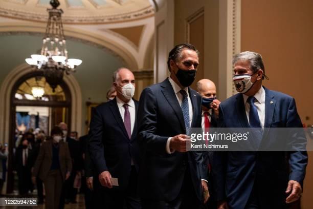 Sen. Mitt Romney and Sen. Joe Manchin walk together from the Senate Chamber to the House Chamber ahead of President Joe Bidens address of the Joint...
