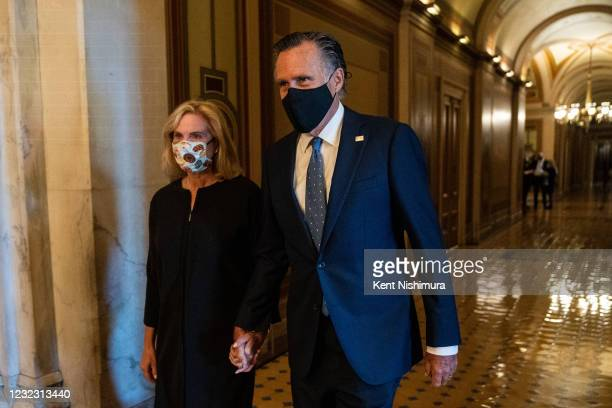 Sen. Mitt Romney and wife, Ann Romney walk in the U.S. Capitol Building after paying respects to US Capitol Police Officer William Billy Evans who is...