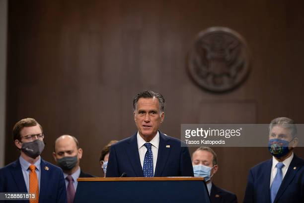 Sen. Mitt Romney speaks alongside a bipartisan group of Democrat and Republican members of Congress as they announce a proposal for a Covid-19 relief...