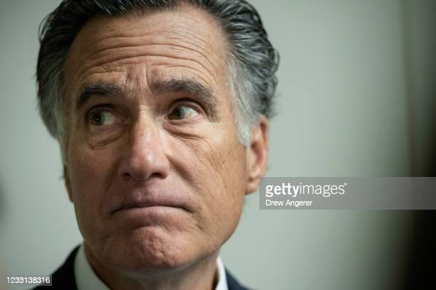 Sen. Mitt Romney speaks to reporters about the January 6 commission legislation in the Senate subway after a vote on Capitol Hill May 27, 2021 in...