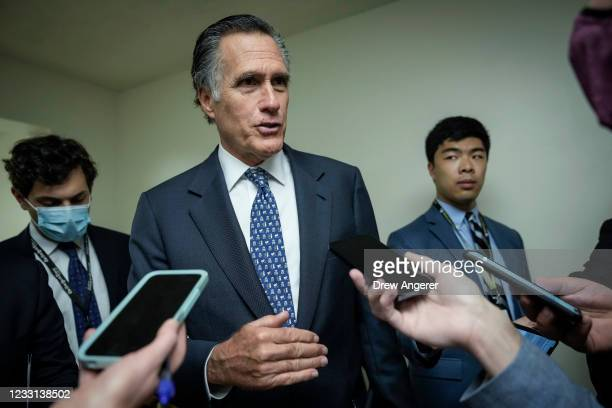 Sen. Mitt Romney speaks to reporters in the Senate subway after a vote on Capitol Hill May 27, 2021 in Washington, DC. The mother of late Capitol...