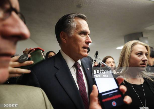 Sen. Mitt Romney speaks to reporters upon arrival to the U.S. Capitol for the Senate impeachment trial on January 28, 2020 in Washington, DC....