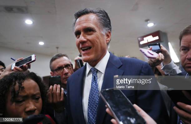 Sen. Mitt Romney speaks to reporters upon arrival to the U.S. Capitol for the Senate impeachment trial on January 29, 2020 in Washington, DC....