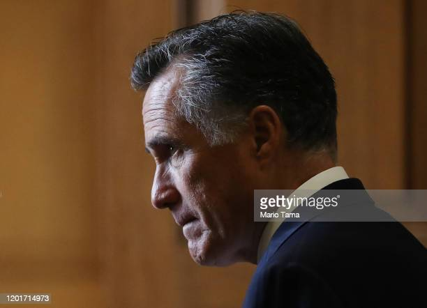 Sen. Mitt Romney stands in a hallway near the Senate chamber in the U.S. Capitol on January 24, 2020 in Washington, DC. Impeachment trial proceedings...