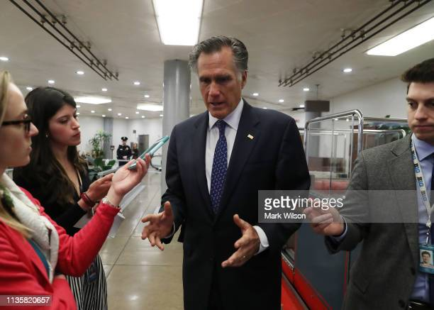 Sen Mitt Romney talks to reporters after the Senate voted to overturn the President's national emergency border declaration at the US Capitol on...