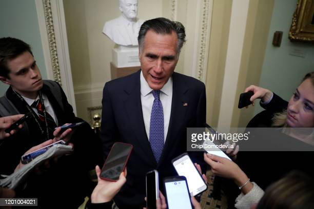 Sen Mitt Romney talks to reporters before heading into the weekly Senate Republican policy luncheon at the US Capitol January 21 2020 in Washington...