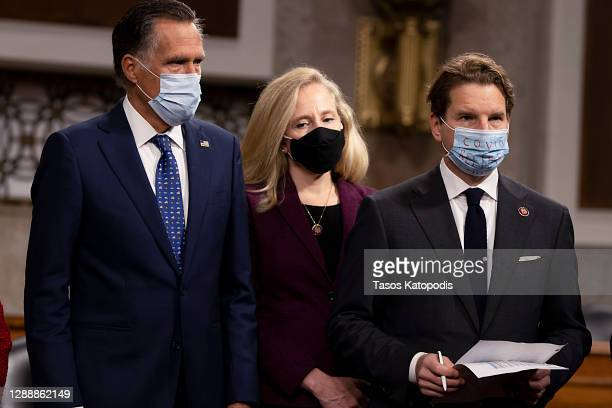 Sen. Mitt Romney , US Rep. Abigail Spanberger and US Rep. Dean Phillips alongside a bipartisan group of Democrat and Republican members of Congress...