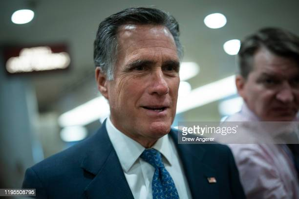 Sen. Mitt Romney walks through the Senate subway as he arrives for the impeachment trial of President Donald Trump resumes at the U.S. Capitol on...
