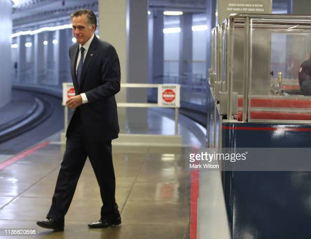 Sen Mitt Romney walks through the US Capitol prior to the Senate voting to overturn the President's national emergency border declaration at the US...