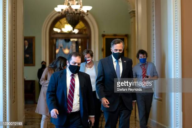 Sen. Mitt Romney wears a protective mask while walking through the U.S. Capitol on December 11, 2020 in Washington, DC. The Senate passed a one week...