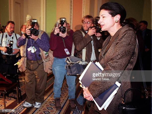 Sen Olympia Snowe makes her way past photographers as she leaves the Senate chamber at the end of the second session of the impeachment trial of US...