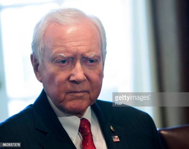 Sen Orrin Hatch Chairman of the Senate Finance Committee listens to US President Donald Trump speak during a meeting with members of the Senate...