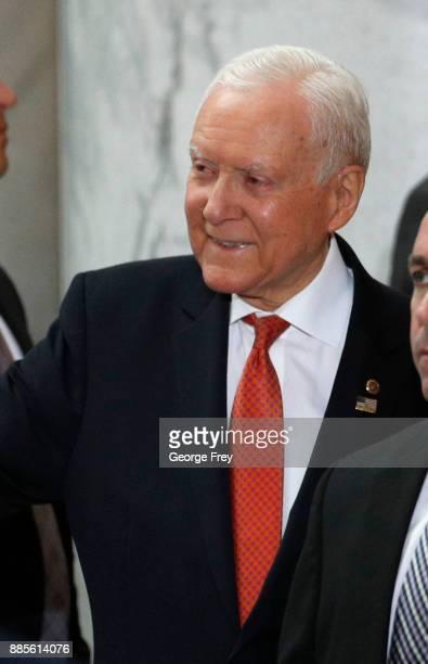 Sen Orrin Hatch listens to US President Donald Trump speak at the Rotunda of the Utah State Capitol on December 4 2017 in Salt Lake City Utah Trump...