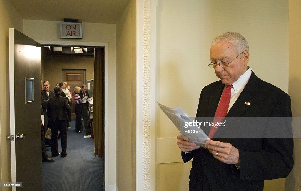 Sen. Orrin Hatch, R-Utah, looks over some papers in the hallway outside of the Senate Radio/TV Gallery as he waits for Senate Judiciary Chairman Patrick Leahy, D-Vt., to arrive for a news conference on the 'Patent Reform Act of 2007' on Wednesday, April 18, 2007.