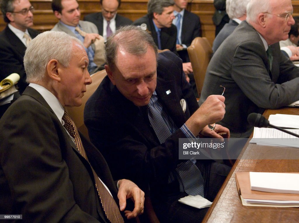 Sen. Orrin Hatch, R-Utah, speaks with Sen. Arlen Specter, R-Pa., before the Senate Judiciary Committee voted to authorize subpoenas for Bush administration officials to aide the investigation of the firing of federal prosecuters on Thursday, March 22, 2007.