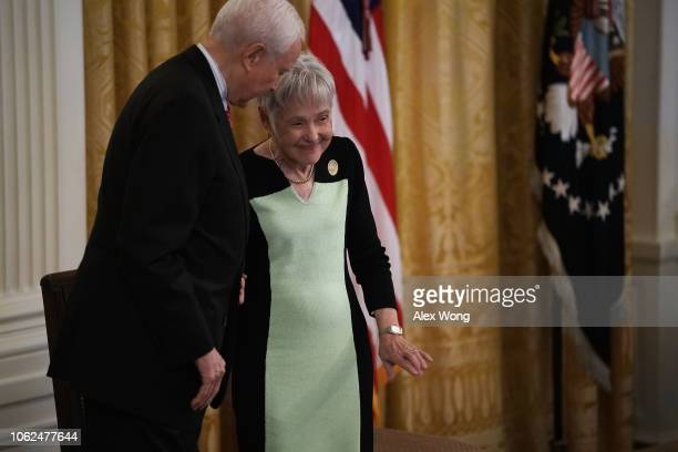 S Sen Orrin Hatch shares a moment with Maureen Scalia widow of the late US Supreme Court Justice Antonin Scalia on stage during a presentation...