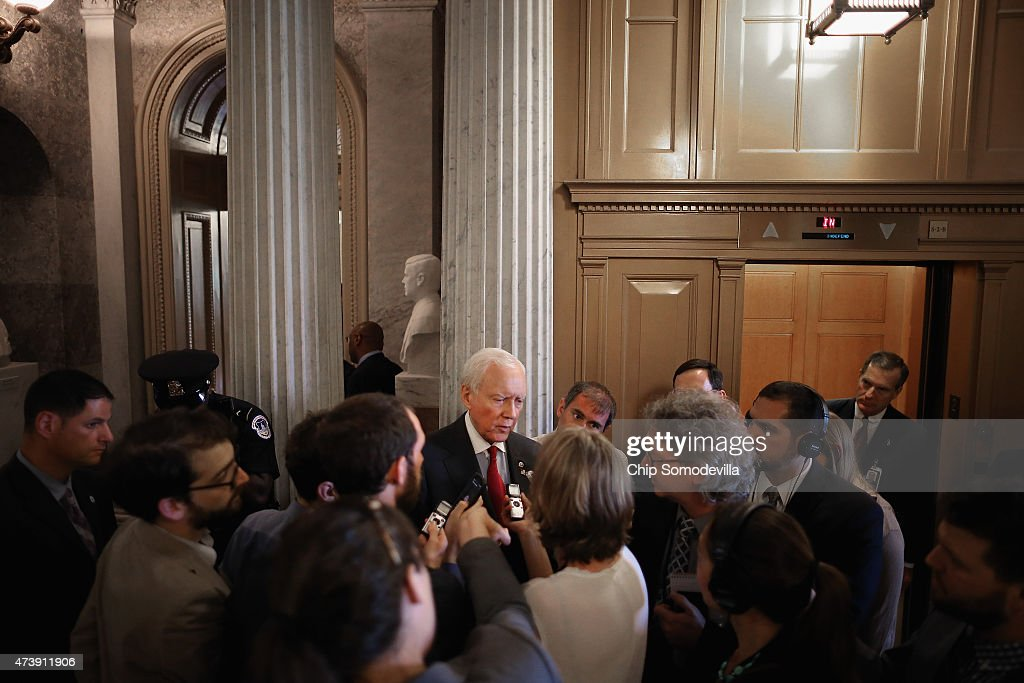 Sen. Orrin Hatch (R-UT) (C) talks with reporters after leaving the Senate floor at the U.S. Capitol May 18, 2015 in Washington, DC. Senate Majority Leader Mitch McConnell (R-KY) said that he will postpone the Senate's Memorial Day recess until lawmakers tackle a trade bill, renewal of the Patriot Act and funding for federal highways.