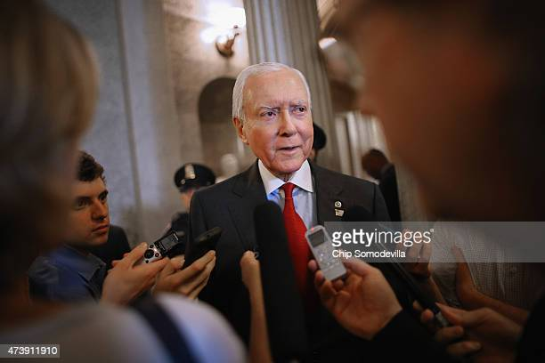 Sen Orrin Hatch talks with reporters after leaving the Senate floor at the US Capitol May 18 2015 in Washington DC Senate Majority Leader Mitch...