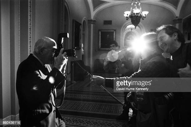 Sen Pat Leahy an amateur photographer talks with photojournalists Scott Applewhite and Chuck Kennedy in the halls of the US Capitol Building during...