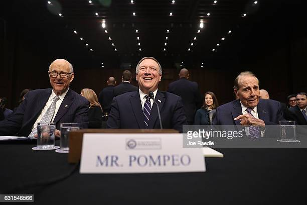 Sen Pat Roberts Rep Mike Pompeo and former Sen Bob Dole take their seats during Mr Pompeo's confirmation hearing to be the director of the CIA before...