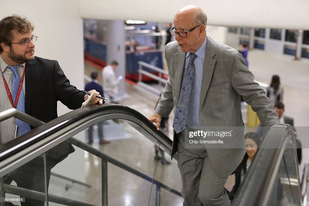 Sen. Pat Roberts (R-KS) talks with reporters while heading to the weekly Republican Democratic policy luncheon at the U.S. Capitol May 17, 2016 in Washington, DC. Leaders from both sides of the aisle met behind closed doors for their weekly policy meetings.