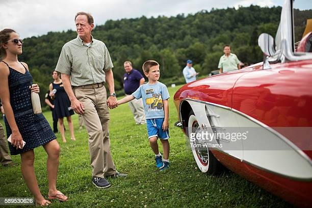 Sen. Pat Toomey, R-Pa., and his son Duncan check out a 1960 Corvette at a car show in Nicholson, Pa., during his statewide bus tour, August 14, 2016.