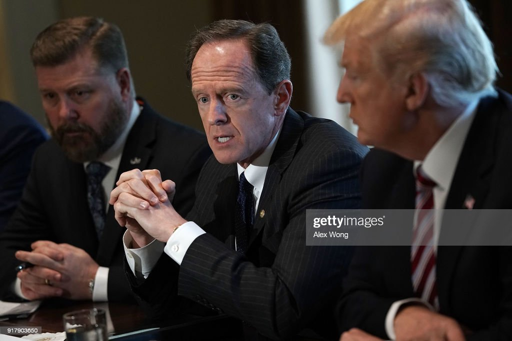 U.S. Sen. Pat Toomey (R-PA) (2nd L) speaks as President Donald Trump (R) listens during a meeting with congressional members in the Cabinet Room of the White House February 13, 2018 in Washington, DC. President Trump held a meeting with congressional members to discuss trade.