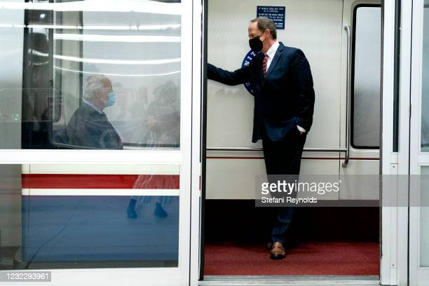 Sen. Pat Toomey speaks to U.S. Sen. Tom Carper in the Senate Subway during a roll call vote on April 13, 2021 in Washington, DC. Senate Republicans...