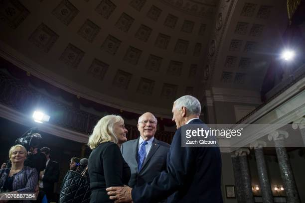 Sen Patrick Leahy and his wife Marcelle Pomerleau speak to Vice President Mike Pence during a mock swearing in ceremony for members of the US Senate...