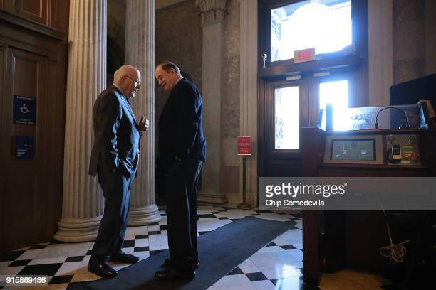 Sen Patrick Leahy and Sen Richard Shelby visit in the halls of the US Captiol following a Republican caucus luncheon February 8 2018 in Washington DC...