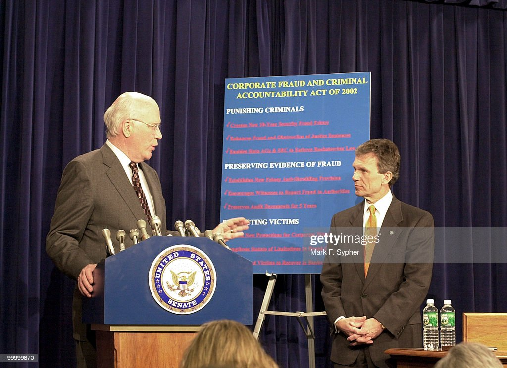 Sen. Patrick Leahy (D-VT) and Senate Majority Leader Tom Daschle (D-SD) at a news conference on securities fraud in the Senate Radio and TV Gallery.