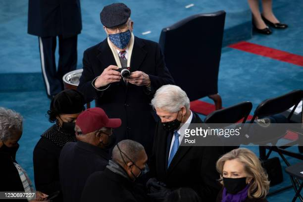 Sen. Patrick Leahy, D-Vt., takes a photo of House Majority Whip Jim Clyburn, D-S.C., Former President Bill Clinton and former Secretary of State...