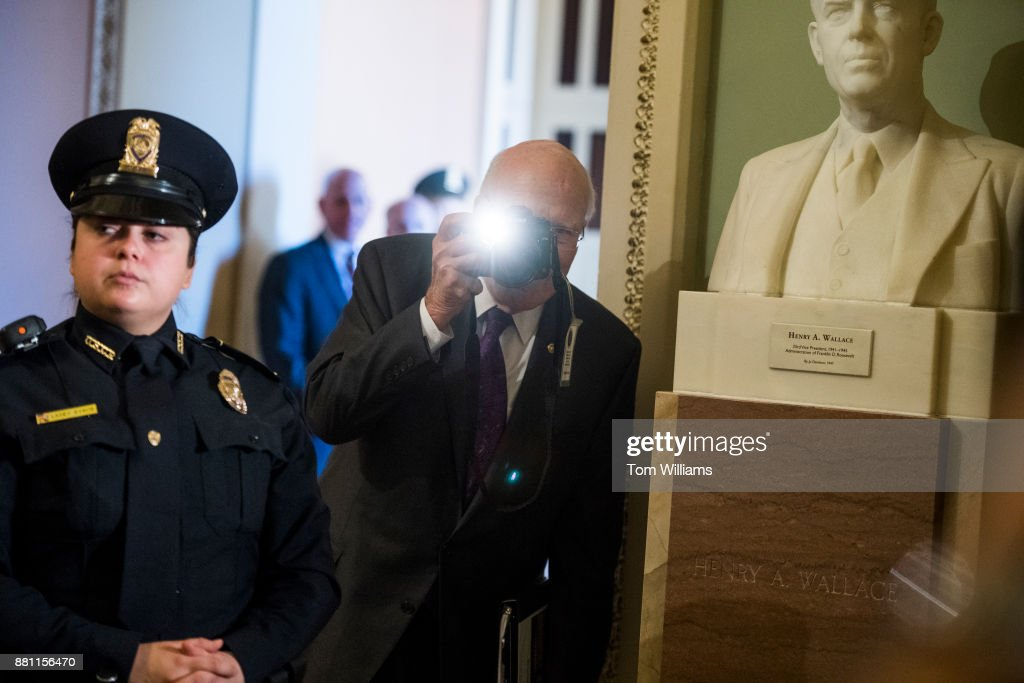 Sen. Patrick Leahy, D-Vt., takes a picture of the media set up for the arrival of President Donald Trump to the Republican Senate Policy luncheon in the Capitol to discuss the tax reform bill on November 28, 2017.