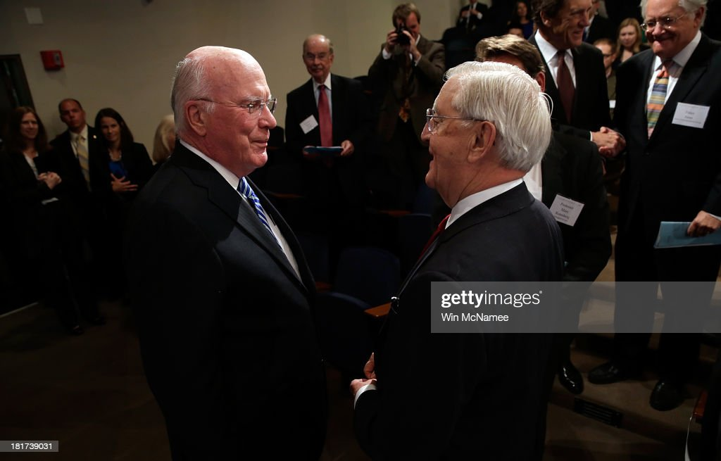 Sen. Patrick Leahy (L) (D-VT) greets former U.S Vice President Walter Mondale (R) at a Georgetown University Law Center discussion September 24, 2013 in Washington, DC. Leahy joined former U.S. Vice President Walter Mondale and former Sen. Gary Hart in discussing 'Surveillance and Foreign Intelligence Gathering in the United States: Past, Present, and Future.'