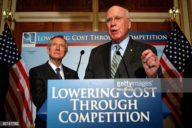 S Sen Patrick Leahy speaks as Senate Majority Leader Sen Harry Reid listens during a news conference October 21 2009 on Capitol Hill in Washington DC...