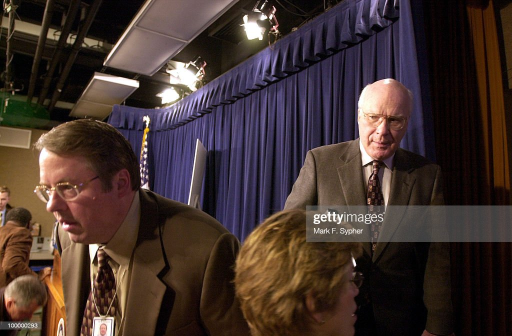 Sen. Patrick Leahy (D-VT) tries to make a quick get away after a news conference on securities fraud in the Senate Radio and TV Gallery.