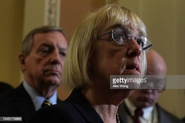 S Sen Patty Murray speaks as Senate Minority Whip Sen Richard Durbin listens after a weekly Senate Democratic policy luncheon September 25 2018 at...