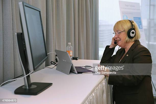 Sen Patty Murray uses Skype and Microsoft automatic translation software to livechat with a man in China during the Microsoft Innovation and Policy...