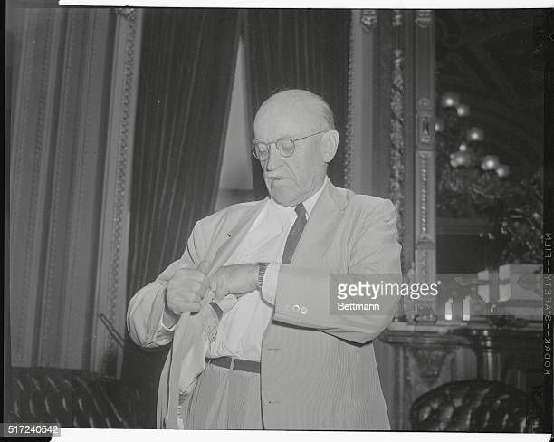 Sen. Ralph E. Flanders searches through his pocket for some papers as he prepares to leave his office for the senate chamber and resumption of debate...