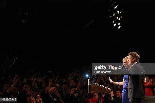 Sen. Rand Paul and his wife Kelley Paul wave to supporters during an event announcing Sen. Paul's candidacy for the Republican presidential...
