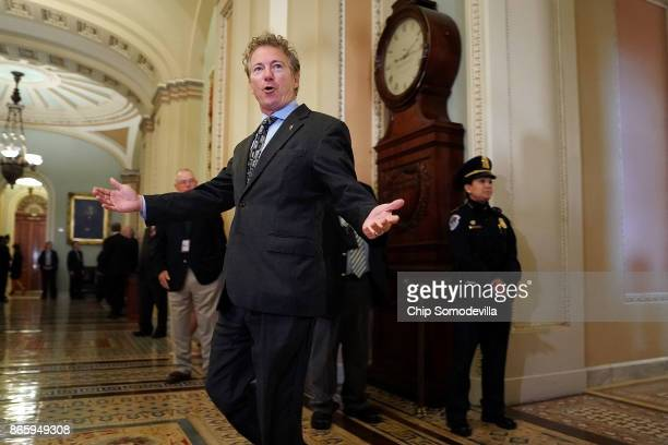Sen Rand Paul gestures toward reporters following the weekly Republican policy luncheon at the US Capitol October 24 2017 in Washington DC Pau and...
