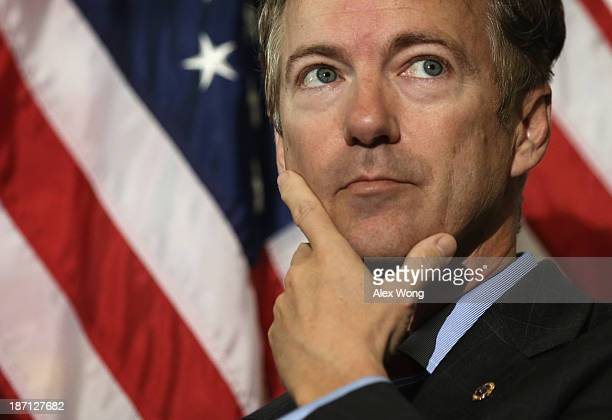 S Sen Rand Paul listens during a news conference on military sexual assault November 6 2013 on Capitol Hill in Washington DC A bipartisan group of...