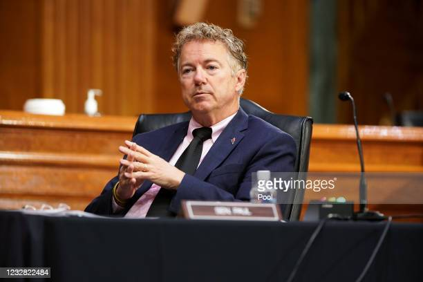 Sen. Rand Paul listens to Dr. Anthony Fauci, director of the National Institute of Allergy and Infectious Diseases, during a Senate Health,...