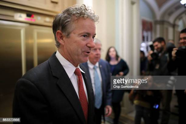 Sen Rand Paul moves through US Capitol during votes November 30 2017 in Washington DC The Senate is debating the proposed GOP tax reform bill and...