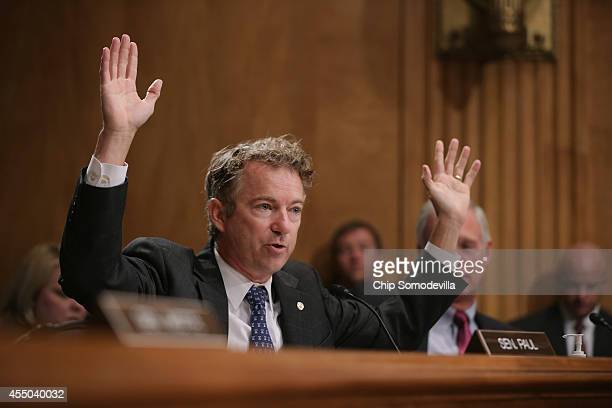 Sen Rand Paul raises his hands in the air while talking about demonstrators who faced militarized police while protesting the shooting of an unarmed...
