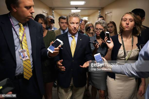 Sen Rand Paul returns to his office after bringing the Senate into session at the US Capitol July 31 2017 in Washington DC Senate GOP leadership was...